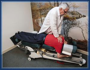 Dr. Donald Krippendorf, Chiropractor, doing an adjustment on a patient Florida Chiropractic Institute in St. Petersburg, Florida